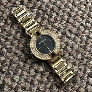 Gold BCBGMaxazria Watch with Black/Rhinestone Face